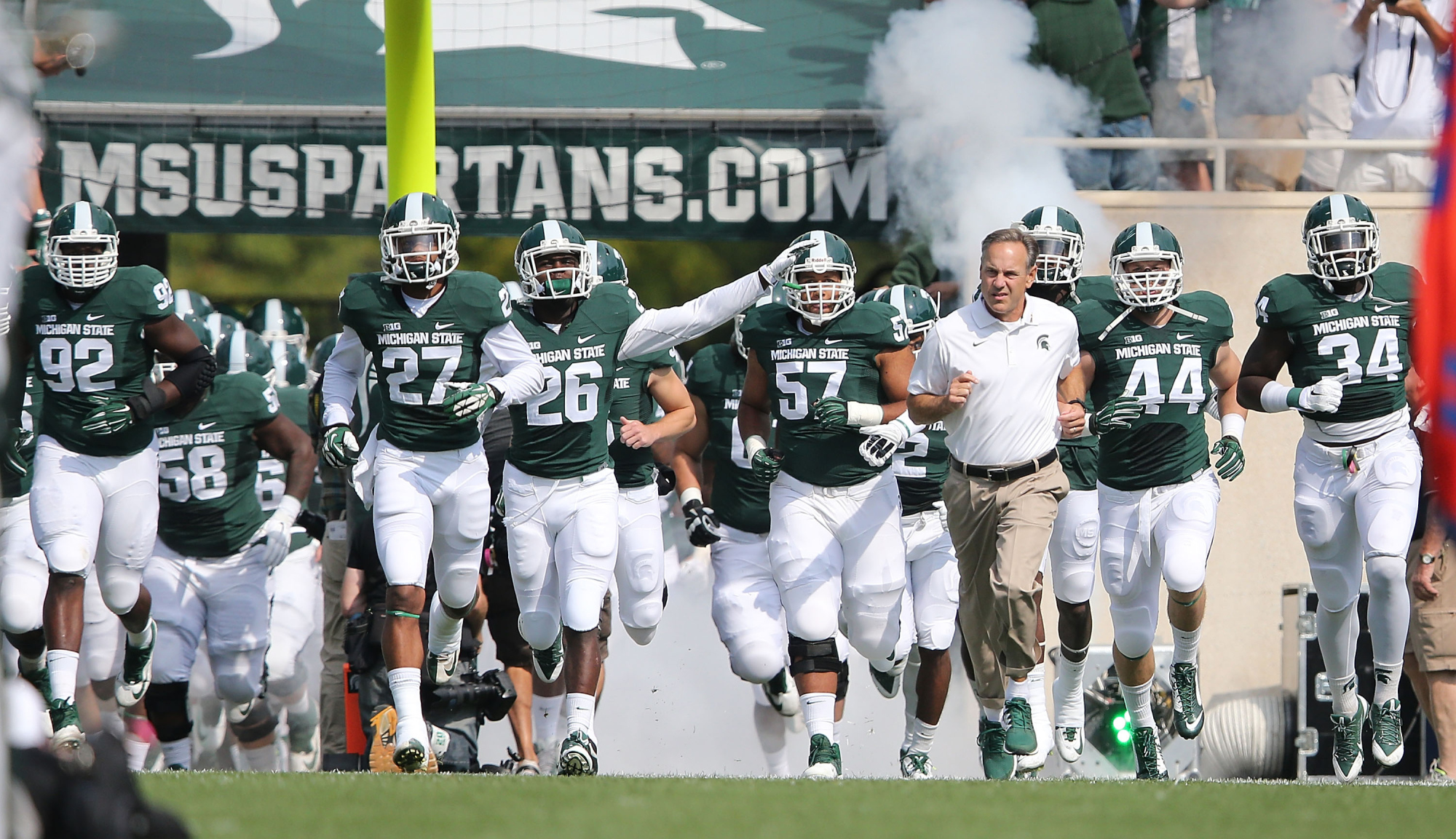 https://thisisspartablogdotcom.files.wordpress.com/2014/10/msu-football-team-entrance.jpg
